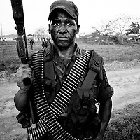 A Government soldier on manoeuvres in the heavily disputed region of Aruaca. The area is rich in oil and large amounts of coca are grown in the firtile soil. Two rebel groups; the FARC and ELN are fighting AUC paramilitaries for domination of the zone.<br />