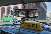 Street scene at Old Havana, seen from inside a Taxi in Havana, Cuba.