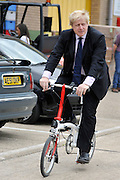 © licensed to London News Pictures. LONDON, UK.  02/06/11. Boris Johnson is shown riding a Brompton folding bike at  Brompton Bicycles in West London. The Mayor of London Boris Johnson visits two major manufacturing firms today, 02 June 2011, to see the role they play in supporting London's economy and why the UK's capital city  is so critical to their continued success. He called in to Fuller's in Chiswick, London's only traditional family brewery, to see their new multi-million pound brewing facility. He went on to visit Brompton bike factory. Where he met Brompton inventor Andrew Ritchie, who still owns the famous company and remains its Technical Director.  Photo credit should read Stephen Simpson/LNP
