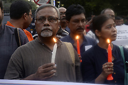 July 8, 2017 - Kolkata, West Bengal, India - A group of activist participates in a candle light vigil against recent communal violence at Baduria of North 24 Parganas  in Kolkata. (Credit Image: © Saikat Paul/Pacific Press via ZUMA Wire)