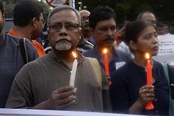 July 8, 2017 - Kolkata, West Bengal, India - A group of activist participates in a candle light vigil against recent communal violence at Baduria of North 24 Parganas  in Kolkata. (Credit Image: © Saikat Paul/Pacific Press via ZUMA Wire)