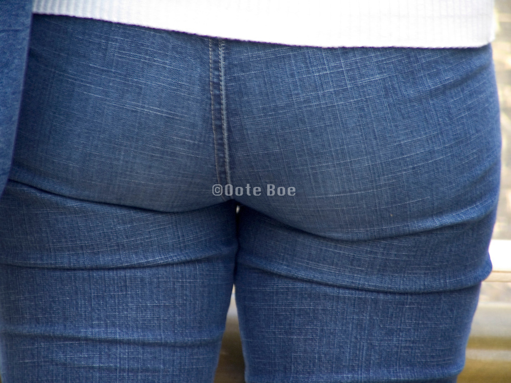 close up of a woman wearing tight jeans