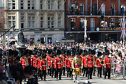Members of the Irish Guards Regimental Band march outside Windsor Castle on Castle Hill ahead of the wedding and carriage procession of Prince Harry and Meghan Markle.