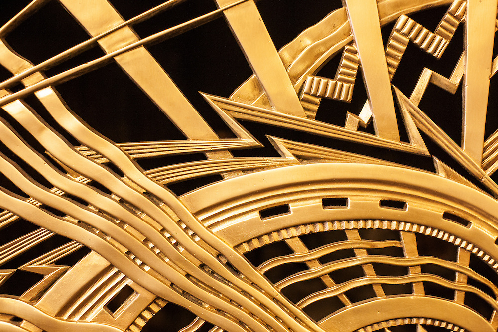 Detail of an Art Deco, gilded bronze grill in the lobby of the Chanin Building, constructed in 1927-1929 . . . The metalwork was designed by the American sculptor René Chambellan and by the building's owner/architect, Irwin Chanin.