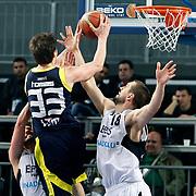 Efes Pilsen's Nikola VUJCIC (R) during their Turkish Basketball league derby match Efes Pilsen between Fenerbahce Ulker at the Sinan Erdem Arena in Istanbul Turkey on Sunday 24 April 2011. Photo by TURKPIX