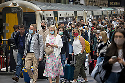 © Licensed to London News Pictures. 10/07/2021. London, UK. Members of the public are seen wearing face masks as they disembark a train at Kings Cross Station in centralLondon. Final lifting of Covid-19 regulations will take place on July 19th. Photo credit: Ben Cawthra/LNP