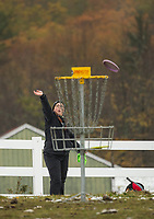 Jennifer Amaral of Methuen, MA throws a putt towards the 17th Tee basket during the Disc Golf Tournament at Castle in the Clouds Sunday.  (Karen Bobotas/for the Laconia Daily Sun)
