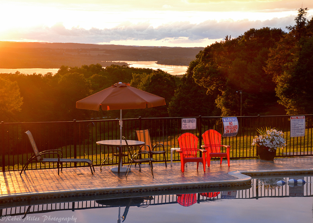 Shanty Creek Resort In Bellaire, Michigan As The Sun Sets Behind The Pool On A Warm Summer Evening.