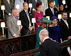 Duke of Edinburgh arrives at the wedding of Princess Eugenie to Jack Brooksbank at St George's Chapel in Windsor Castle, watched by the (back left to right) the Prince of Wales, the Duke and Duchess of Cambridge, the Duke and Duchess of Sussex, (front left to right) Sarah Ferguson, Princess Beatrice and Peter Phillips.