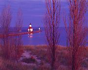 Sunrise illuminating the St. Joseph River North Pier Inner and Outer Lights, Lake Michigan, St. Joseph, Michigan.