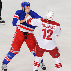 New York Rangers left wing Mike Rupp (71) and Phoenix Coyotes left wing Paul Bissonnette (12) fight during first period NHL action between the Phoenix Coyotes and the New York Rangers at Madison Square Garden.