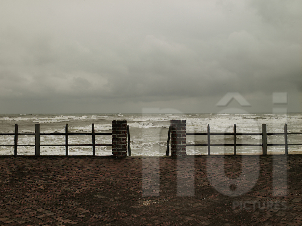 Seafront by a stormy winter day in Dong Hoi, Viet nam, Asia. Sky is very cloudy and grey. Strong waves hit the shore.