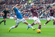 Matthew Kennedy (#33) of St Johnstone FC tackles Michael Smith (#2) of Heart of Midlothian during the Ladbrokes Scottish Premiership match between Heart of Midlothian and St Johnstone at Tynecastle Stadium, Gorgie, Scotland on 29 September 2018.