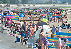 ©Licensed to London News Pictures 07/08/2020   Dymchurch, UK. A very busy beach at Dymchurch in Kent on the south coast. Scorching hot weather today in the UK as the heatwave weather looks set to continue into next week. Today could be one of the hottest on record if not the hottest. Photo credit: Grant Falvey/LNP