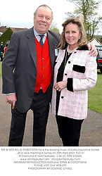 MR & MRS WILLIE ROBERTSON he is the leading music industry insurance broker, at a race meeting in Surrey on 25th April 2003.	PJD 21