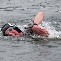LONDON, ENGLAND - DECEMBER 25:  A member of the Serpentine Swimming Club swims in the icy Serpentine waters during the annual Christmas Day Peter Pan Cup on December 25, 2009 in London, England.  The traditional 100 yards Christmas race got its name in 1904 after Sir James Barrie presented the first Peter Pan Cup and is only open to club members who have competed in at least three of the winter series races.   (Photo by Marco Secchi/Getty Images)