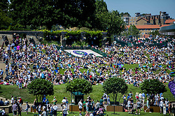 July 2, 2018 - London, United Kingdom - 180702 Crowds of spectators sit on a lawn next to the logo of Wimbledon during day 1 of Wimbledon on July 2, 2018 in London..Photo: Ludvig Thunman / BILDBYRN / kod LT / 35496 (Credit Image: © Ludvig Thunman/Bildbyran via ZUMA Press)