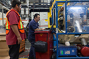 SALTILLO, MEXICO - DECEMBER 23, 2013: Cuauhtemoc Esquivel, (center), 55, provides maintenance to a machine of Flambeau Inc. in Saltillo, Mexico. Flambeau Inc. was settled in Saltillo, Mexico in 1998. The automotive production represent a 60% and the industrial one the 40%. The main products manufactured in Saltillo facilities are the automotive pieces and realistic hunting decoys. CREDIT: Rodrigo Cruz for The New York Times