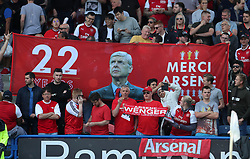 Arsenal fans supporting outgoing manager Arsene Wenger in the stands before the Premier League match at the John Smith's Stadium, Huddersfield.
