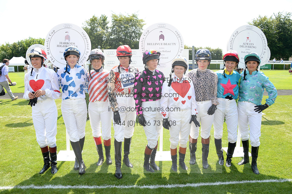 Riders in The Magnolia Cup - Left to right, FRANCESCA CUMANI, ALEXIS GREEN, LUCY HENMAN, TRICIA SIMONON, PHILIPPA HOLLAND, DIDO HARDING, MAGGIE BUGGIE, KRISSI MURISON and GINA BRYCE at the 3rd day of the 2013 Glorious Goodwood racing festival - Ladies day at Goodwood Racecourse, West Sussex on 1st August 2013.