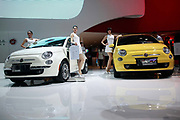 Models stand by Fiat SpA 500 vehicles during the China ( Guangzhou) International Automobile Exhibition in Guangzhou, Guangdong Province, China, on Monday, Nov. 21, 2011. Despite signs of slowing, China remains the largest and fastest growing market for international car makers, especially in the luxury sector.