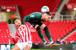 Matt Doherty of Tottenham Hotspur and Jacob Brown of Stoke City contest an aerial ball - Mandatory by-line: Nick Browning/JMP - 23/12/2020 - FOOTBALL - Bet365 Stadium - Stoke-on-Trent, England - Stoke City v Tottenham Hotspur - Carabao Cup