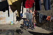 Kilis, near Syrian - Turkish border. Abu Abdo, 72 years, refugee from Aleppo,  with two of his children, his son Yousef 5 years and daugther, Baraah 3 years. He has found no work in Turkey, they live with people 5 in one tiny room, with a monthly rent of 200 dollar, the house owner asked them to leave the place. Abu says he will return to Aleppo, he has no money to stay in Turkey.