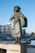 Bronze statue of a female salt worker (Salineira) overlooking the canal, Aveiro, Portugal