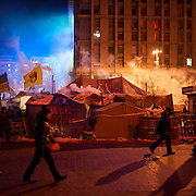 January 24, 2014 - Kiev, Ukraine: People pass by some makeshift tents set up by protestors in Independence Square, also know as Maidan, in central Kiev. (Paulo Nunes dos Santos)