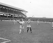 Clare and Dublin both jump for slitor during the Dublin v Clare All Ireland Junior Camogie Final in Croke Park on the 15th of September 1974.