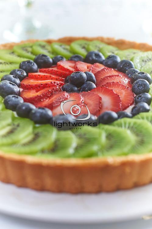 fresh organic fruit tart in a garden setting.