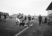 J Fortune, Irish right wing handles a New Zealander into touch,..Irish Rugby Football Union, Ireland v New Zealand, Tour Match, Landsdowne Road, Dublin, Ireland, Saturday 7th December, 1963,.7.12.1963, 12.7.1963,..Referee- H Keenen, Rugby Football Union, ..Score- Ireland 5 - 6 New Zealand, ..Irish Team, ..T J Kiernan, Wearing number 15 Irish jersey, Full Back, Cork Constitution Rugby Football Club, Cork, Ireland,..J Fortune, Wearing number 14 Irish jersey, Right Wing, Clontarf Rugby Football Club, Dublin, Ireland,..P J Casey, Wearing number 13 Irish jersey, Right Centre, University College Dublin Rugby Football Club, Dublin, Ireland, ..J C Walsh,  Wearing number 12 Irish jersey, Left Centre, University college Cork Football Club, Cork, Ireland,..A T A Duggan, Wearing number 11 Irish jersey, Left Wing, Landsdowne Rugby Football Club, Dublin, Ireland,..M A English, Wearing number 10 Irish jersey, Stand Off, Landsdowne Rugby Football Club, Dublin, Ireland, ..J C Kelly, Wearing number 9 Irish jersey, Captain of the Irish team, Scrum Half, University College Dublin Rugby Football Club, Dublin, Ireland,..P J Dwyer, Wearing number 1 Irish jersey, Forward, University College Dublin Rugby Football Club, Dublin, Ireland, ..A R Dawson, Wearing number 2 Irish jersey, Forward, Wanderers Rugby Football Club, Dublin, Ireland, ..R J McLoughlin, Wearing number 3 Irish jersey, Forward, Gosforth Rugby Football Club, Newcastle, England, ..W J McBride, Wearing number 4 Irish jersey, Forward, Ballymena Rugby Football Club, Antrim, Northern Ireland,..W A Mulcahy, Wearing number 5 Irish jersey, Forward, Bective Rangers Rugby Football Club, Dublin, Ireland,  ..E P McGuire, Wearing number 6 Irish jersey, Forward, University college Galway Football Club, Galway, Ireland,  ..P J A O' Sullivan, Wearing  Number 8 Irish jersey, Forward, Galwegians Rugby Football Club, Galway, Ireland,..N A Murphy, Wearing number 7 Irish jersey, Forward, Cork Constitution Rugby Football Club, Cork, Ireland,..New Z