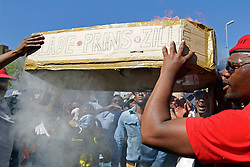 Wednesday 26 October 2016.<br /> Parliament, Cape Town,<br /> Western Cape,<br /> South Africa<br /> <br /> Fees Must Fall Protest March In Cape Town.<br /> <br /> Protesters throw a burning cardboard coffin at the Police while protesting outside Parliament in Cape Town. This action caused the Police to retaliate and disperse students and other protesters with stun grenades and shooting rubber bullets.<br /> <br /> Students and supporters march to parliament in protest against higher education fees in South Africa on the 26th October 2016. The students are protesting against the fees for higher education. This protest is part of the #FeesMustFall campaign.<br /> <br /> Picture By: Mark Wessels/ RealTime Images.