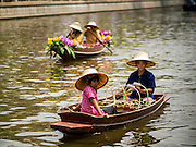14 FEBRUARY 2015 - BANGKOK, THAILAND: Vendors paddle their canoes at the new floating market opened in Khlong Phadung Krung Kasem, a 5.5 kilometre long canal dug as a moat around Bangkok in the 1850s. The floating market opened at the north end of the canal near Government House, which is the office of the Prime Minister. The floating market was the idea of Thai Prime Minister General Prayuth Chan-ocha. The market will be open until March 1.    PHOTO BY JACK KURTZ