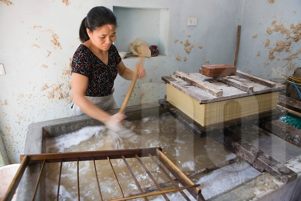 Cham Khe village is specialised in the production of paper. Worker in a paper workshop.