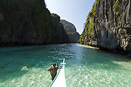 One of the many secluded coves on an island just off shore from El Nido Town, Palawan Philippines.