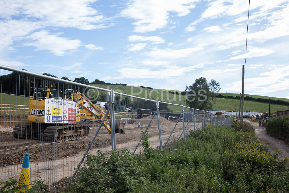 A temporary haul road is prepared for HGVs to use in the construction of a ventilation shaft for the Chiltern Tunnel on the HS2 high-speed rail link on 18th July 2020 in Chalfont St Giles, United Kingdom. The Department for Transport approved the issuing of Notices to Proceed by HS2 Ltd to the four Main Works Civils Contractors MWCC working on the £106bn rail project in April 2020.