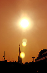 LILLE , FRANCE -  The spire of the St. Maurice Church and dome of the Dupont building at sunset. Lille, France was named the 2004 European Capital of Culture. (Photo © Jock Fistick)