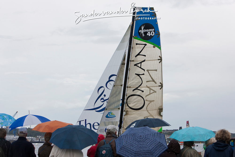 Kiel - Germany, 29th of August 2009. iShares cup. Second day of racing...The crowd is watching the extreme 40's racing close to the shore. Even the rain didn't stop the spectators watching. In the background Oman Sail's Renaissance.