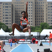Tianna Bartoletta, USA, finishing second in the Women's long Jump competiton with a jump of 6.89m during the Diamond League Adidas Grand Prix at Icahn Stadium, Randall's Island, Manhattan, New York, USA. 13th June 2015. Photo Tim Clayton
