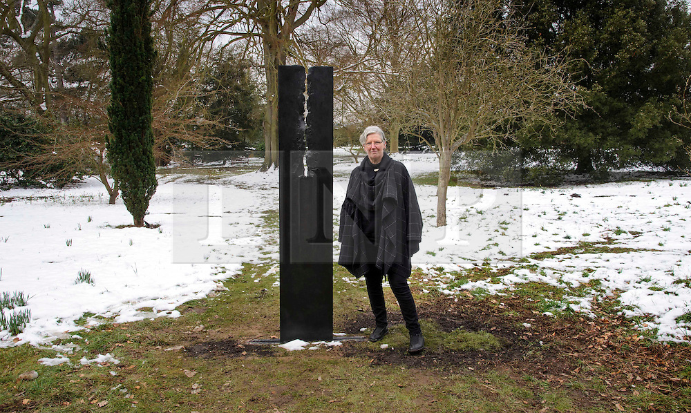 © Licensed to London News Pictures. 27/03/2013 Hatfield UK. Ann Christopher with her 'Dark Line' sculpture at Hatfield House, Herts. Her work is part of a Royal Academy exhibition that showcases six of their artists. This is the first time that the Royal Academy of Arts has collaborated with another organisation to curate an exhibition of Royal Academicians' sculpture outside the Royal Academy..Photo credit : Simon Jacobs/LNP
