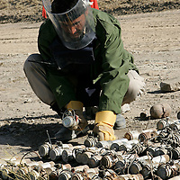 A member of Halo trust team prepares bomb fuses for disposal. Afghanistan remains one of the most heavily mined countries in the world. A mine clearance team from the Halo Trust have been working for more than a year in the small village of Kohe Safi and have removed 800 mines and 118 unexploded bombs. Kohe Safi, Afghanistan on the 1st of November 2007..Throughout the country the Halo Trust alone is working to clear 90 million square meters of mine fields containing some 640,000 mines, they estimate it will take them 18 years to complete this task..A break through in mine detection not seen since  World War II is due to speed things up in the coming year when Halo become the first civllian organisation to use H-STAMIDS (The Handheld Stand-Off Mine Detection System) a new combination tool with a metal detector and ground penetrating radar system. The H-STAMIDS remain classified and during recent trails in Afghanistan the device had to be returned to the US military at the end of each day. The new equipment should make mine clearance 2-3 times faster.