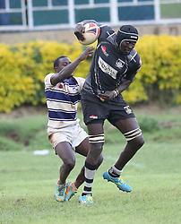 Humphrey Khayange (C) of Mwamba RFU ishakes of Isaac Waweru of Mean Machine during their Kenya Cup Tournament at Railway Club In Nairobi, on 3rd December 2016. Mwamba won 51-8. Photo/Fredrick Onyango/www.pic-centre.com (KEN)