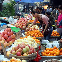 Asia, China, Chongqing. Local street produce and fruit market in the city of Chongqing.