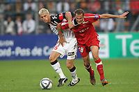 FOOTBALL - FRENCH CHAMPIONSHIP 2010/2011 - L1 - VALENCIENNES v LENS - 18/09/2010 - PHOTO ERIC BRETAGNON / DPPI - YOHAN DEMONT (LENS) / GREGORY PUJOL (VA)