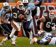 MORNING JOURNAL/DAVID RICHARD.Cleveland runningback Rueben Droughns rushes for a first down on a third-and-16 play yesterday against the Titans.