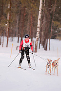 Photo Randy Vanderveen.Grande Prairie , Alberta.13-01-05.Lisa Saffel urges her dogs through the race course as she takes part in the skijor event ? dogs pull the musher around the course on skis as opposed to a sled. The Grande Prairie Sled Dog Derby ran two days of races at Evergreen Park this past weekend, Jan. 5 and 6.