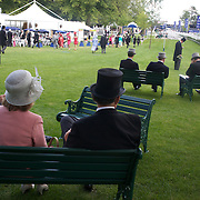 Race goers relax before the start of the races at Royal Ascot Race Course. Royal Ascot is one of the most famous race meetings in the world, frequented by Royalty and punters from the high end of society to the normal everyday working class. Royal Ascot 2009, Ascot, UK, on Tuesday, June 16, 2009. Photo Tim Clayton