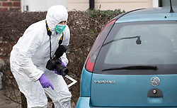 © Licensed to London News Pictures. 05/01/2019. Farnham, UK. A police forensics officer gathers evidence from a car parked outside a property in Farnham, Surrey after a couple were arrested in connection with the murder of a man on a train yesterday. A murder investigation has been launched after the man was attacked while on board the 12. 58pm train service travelling between Guildford and London Waterloo. A man and a woman have been detained by police in Farnham in connection with the murder. Photo credit: Peter Macdiarmid/LNP