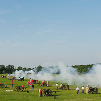 An array of canons open fire during the 149th Gettysburg Reenactment in Gettysburg, Pennsylvania on July 6, 2012.